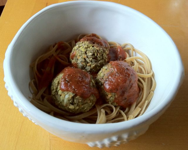 Vegan Lentil meatballs served over whole wheat pasta.